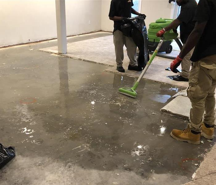 Water on floor and carpet removed from storm water