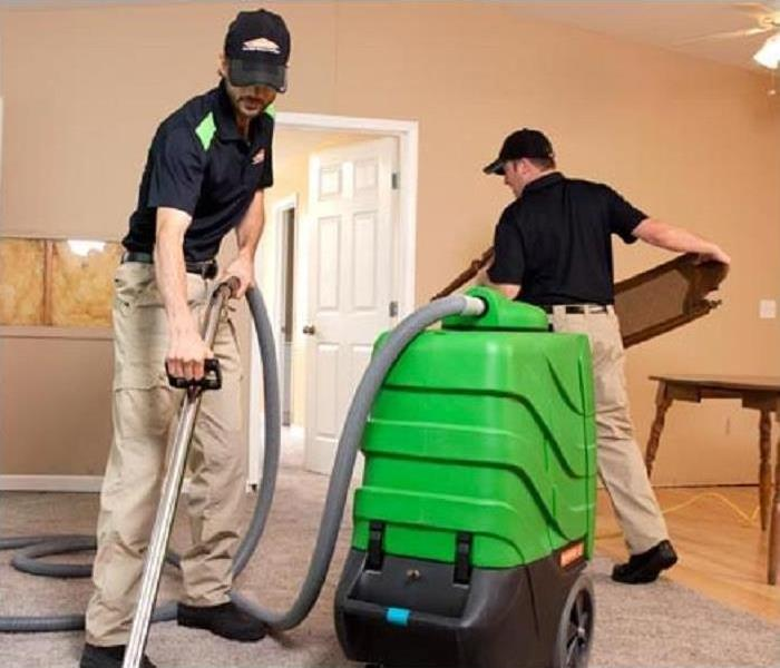 SERVPRO technicians drying a room